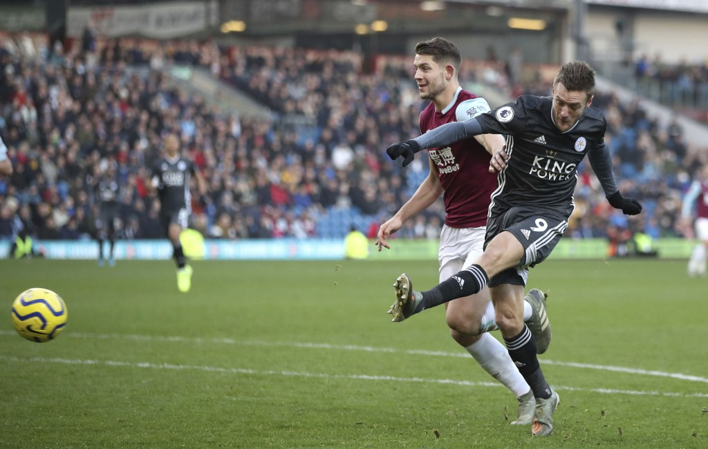 Leicester City's Jamie Vardy, right, has an unsuccessful shot on goal under pressure form Burnley's James Tarkowski, during  their English Premier Lea...