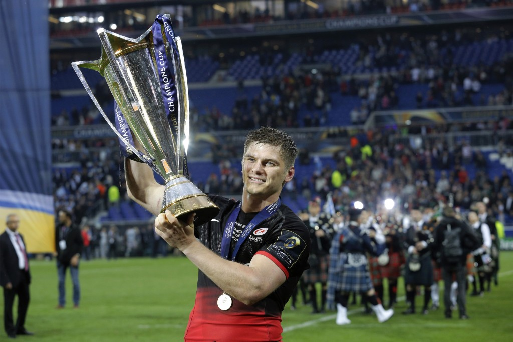 FILE - In this Saturday, May 14, 2016 file photo, Saracens' Owen Farrell celebrates with the trophy after winning their European Rugby Champions Cup f...