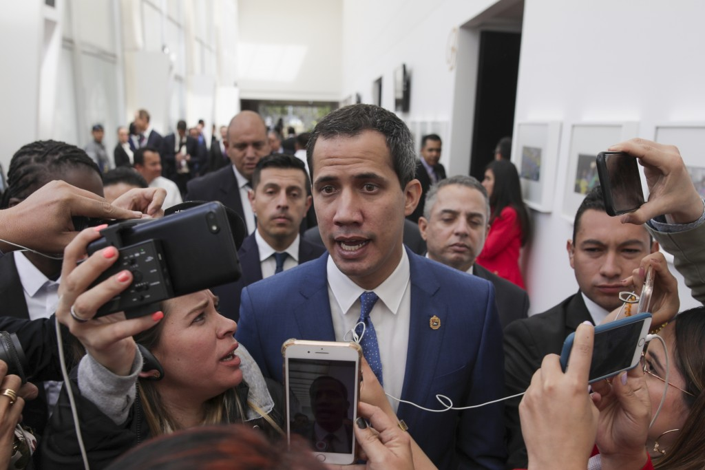 Venezuela's opposition leader Juan Guaido speaks to journalists during a regional counter-terrorism meeting at the police academy in Bogota Colombia