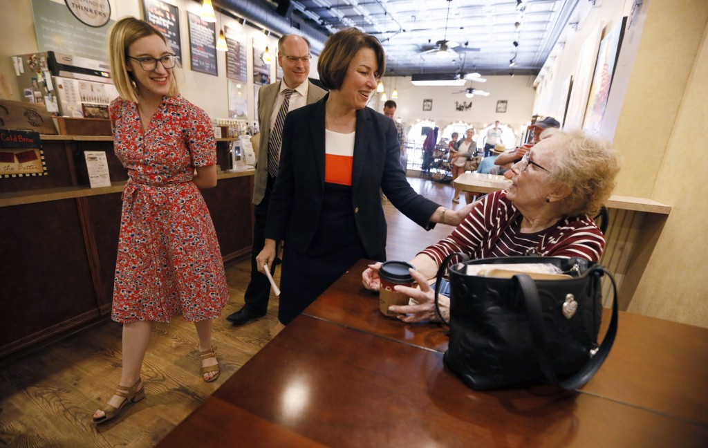 FILE - In this May 25, 2019, file photo, Democratic presidential candidate Sen. Amy Klobuchar, D-Minn., center, and her daughter Abigail, left, talks ...