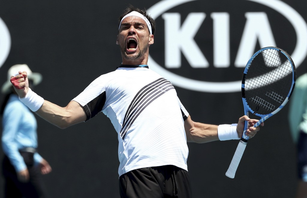 Italy's Fabio Fognini celebrates after defeating Reilly Opelka of the U.S. in their first round singles match at the Australian Open tennis championsh...