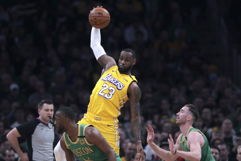 Los Angeles Lakers forward LeBron James (23) leaps for a pass as he is covered by Boston Celtics forward Gordon Hayward (20) during the first half of ...