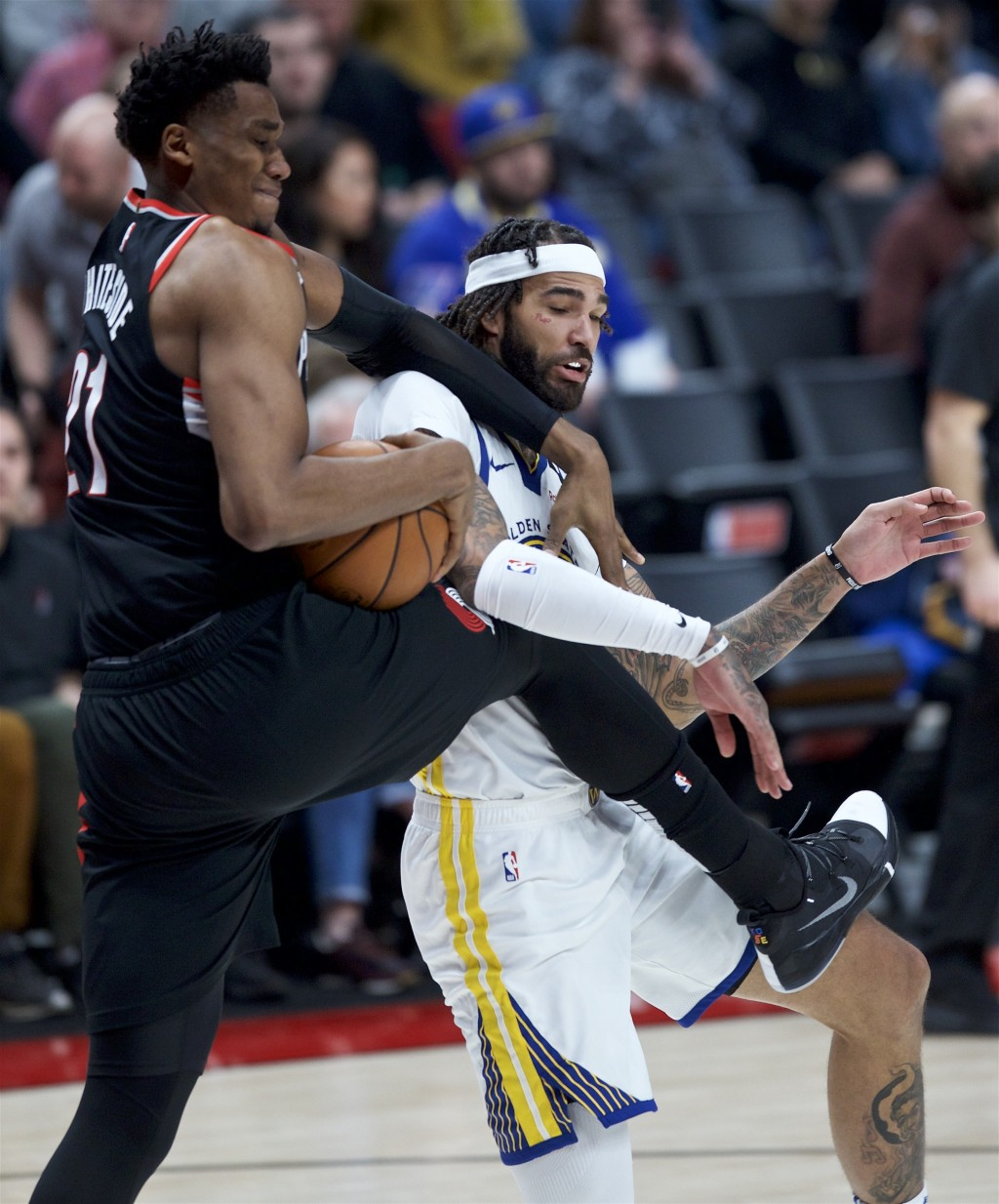 Portland Trail Blazers center Hassan Whiteside, left, and Golden State Warriors center Willie Cauley-Stein vie for the ball during the second half of ...