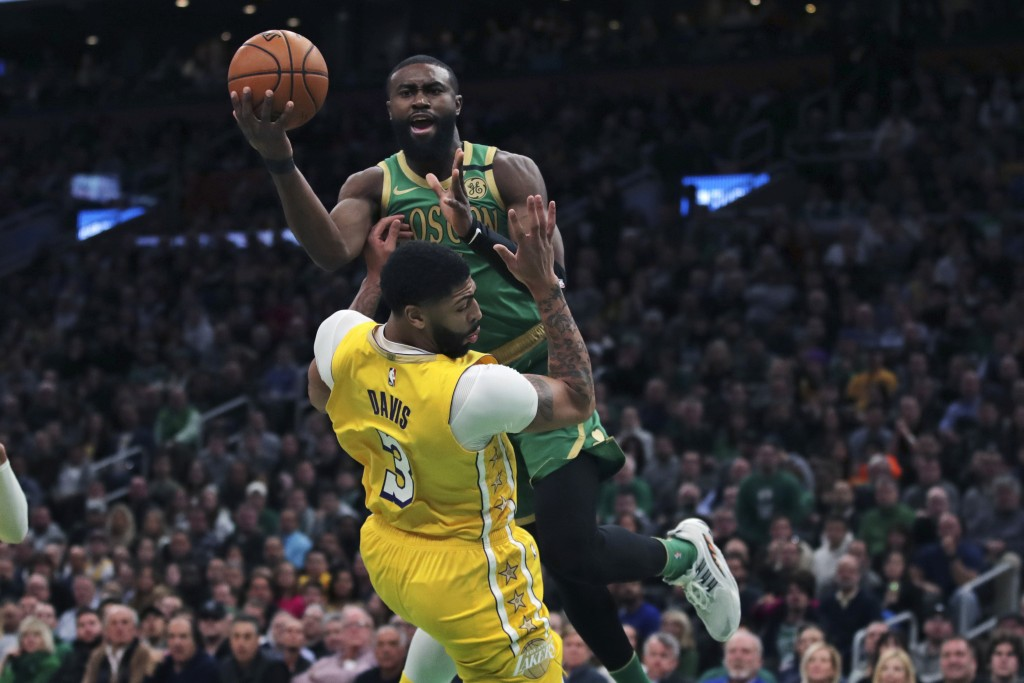 Boston Celtics guard Jaylen Brown drives to the basket against Los Angeles Lakers forward Anthony Davis (3) during the first half of an NBA basketball...