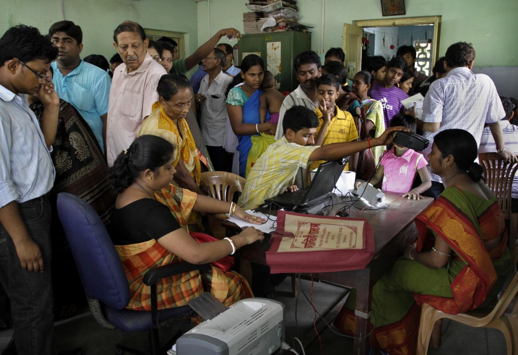 In this Wednesday, May 16, 2012, file photo, Indians crowd a room as they wait to enroll for Aadhar, India's unique identification project in Kolkata,...