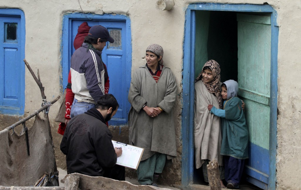 In this Wednesday, Feb. 9, 2011, file photo, census workers take details of a Kashmiri family on the outskirts of Srinagar, India. India has been embr...