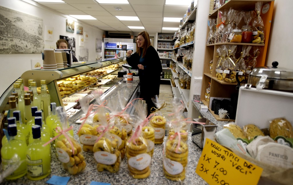 In this image taken on Thursday, Jan. 16, 2020, Federica Molin, manager of the Palmisano bakery that sells Bussolai, a kind of local traditional biscu...