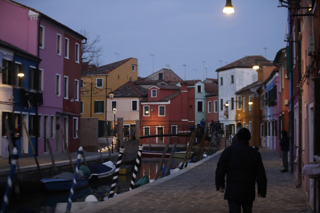 In this image taken on Thursday, Jan. 16, 2020, people walk at the Burano island, Italy. The Venetian island of Burano's legacy as a fishing village r...