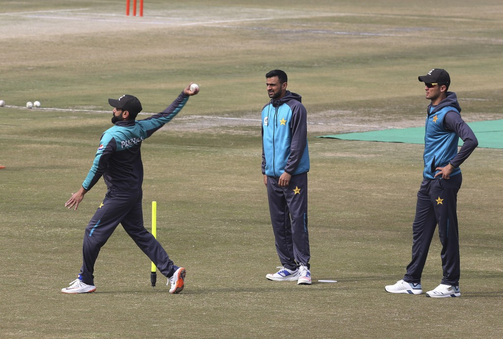 Pakistani cricket players Mohammad Hafeez, left, Shoaib Malik, center, and Shaheen Shah Afridi attend a practice session for the upcoming series again...