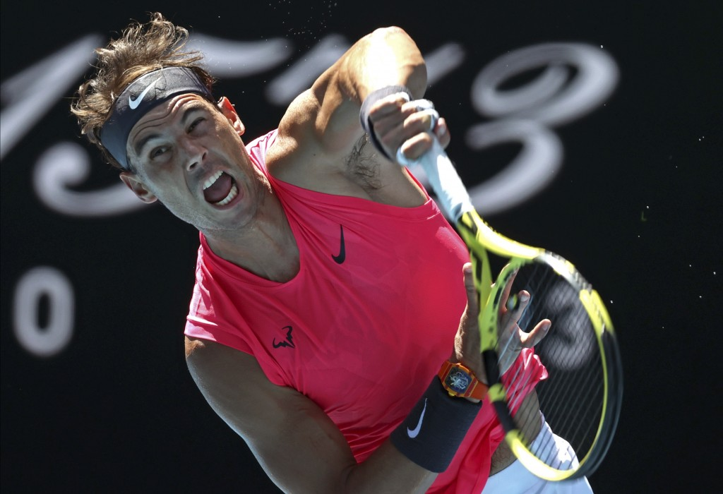 Spain's Rafael Nadal serves to Bolivia's Hugo Dellien during their first round singles match at the Australian Open tennis championship in Melbourne, ...