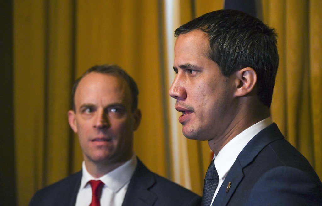 Venezuela's Opposition leader Juan Guaido, right, during a meeting with British Foreign Secretary Dominic Raab at Foreign Office in London, Tuesday, J...