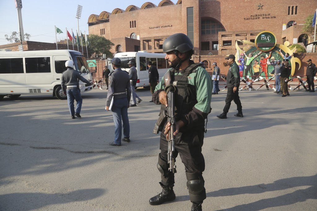An armed guard stands alert outside the Gaddafi Stadium, Wednesday, Jan. 22, 2020. The three-match Twenty20 cricket series between Pakistan and Bangla...