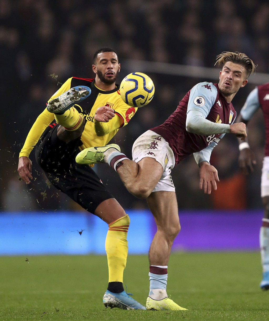 Watford's Etienne Capoue, left, and Aston Villa's Jack Grealish battle for the ball during a Premier League soccer match at Villa Park Tuesday, Jan. 2...