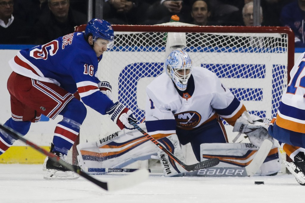 New York Islanders goaltender Thomas Greiss (1) defends his net from New York Rangers' Ryan Strome (16) during the first period of an NHL hockey game ...
