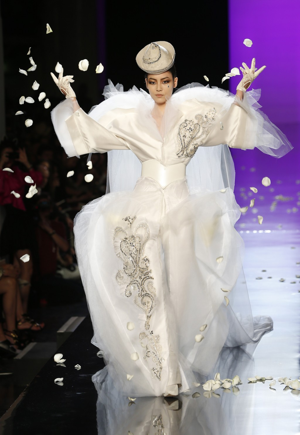 FILE - In this Wednesday, July 3, 2013 file photo, a model wears the wedding gown for Jean-Paul Gaultier's Haute Couture Fall-Winter 2013-2014 collect...