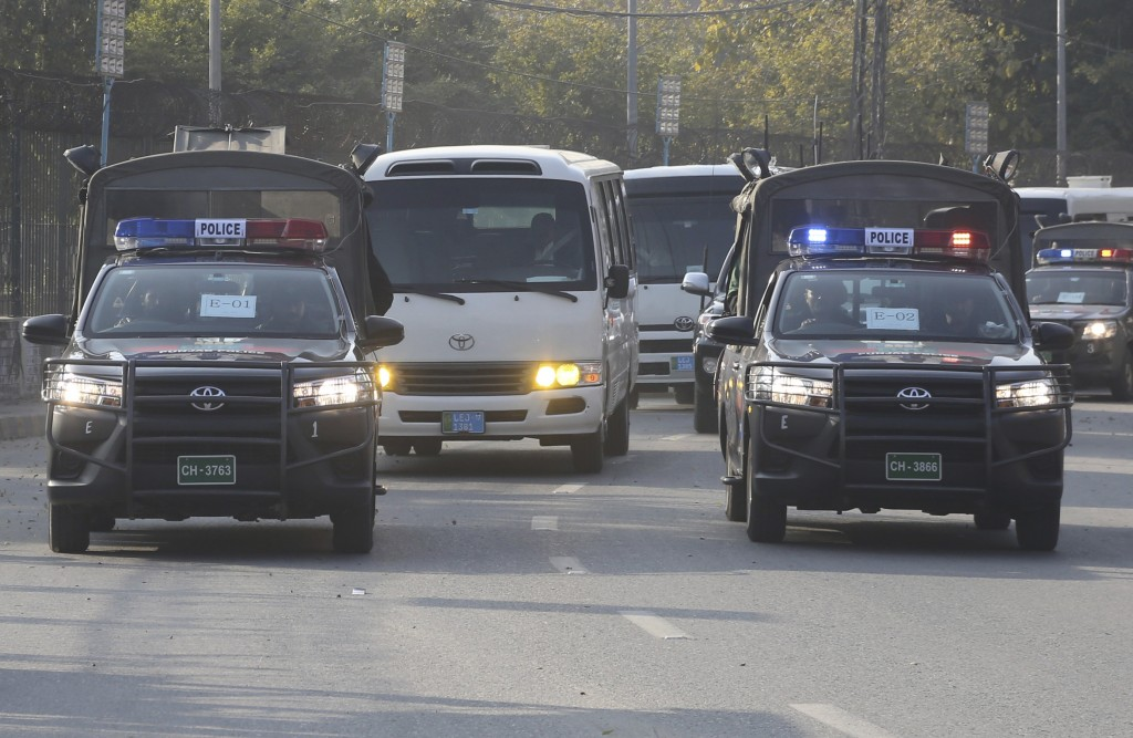 A heavily guarded Pakistan cricket team bus arrives at the Gaddafi Stadium for practice, Wednesday, Jan. 22, 2020. The three-match Twenty20 series bet...