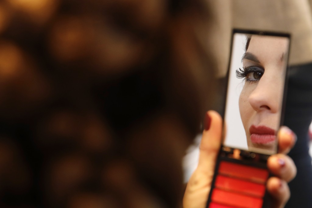 A model checks herself in a mirror backstage prior to the Franck Sorbier Haute Couture Spring/Summer 2020 fashion collection presented Tuesday Jan. 21...