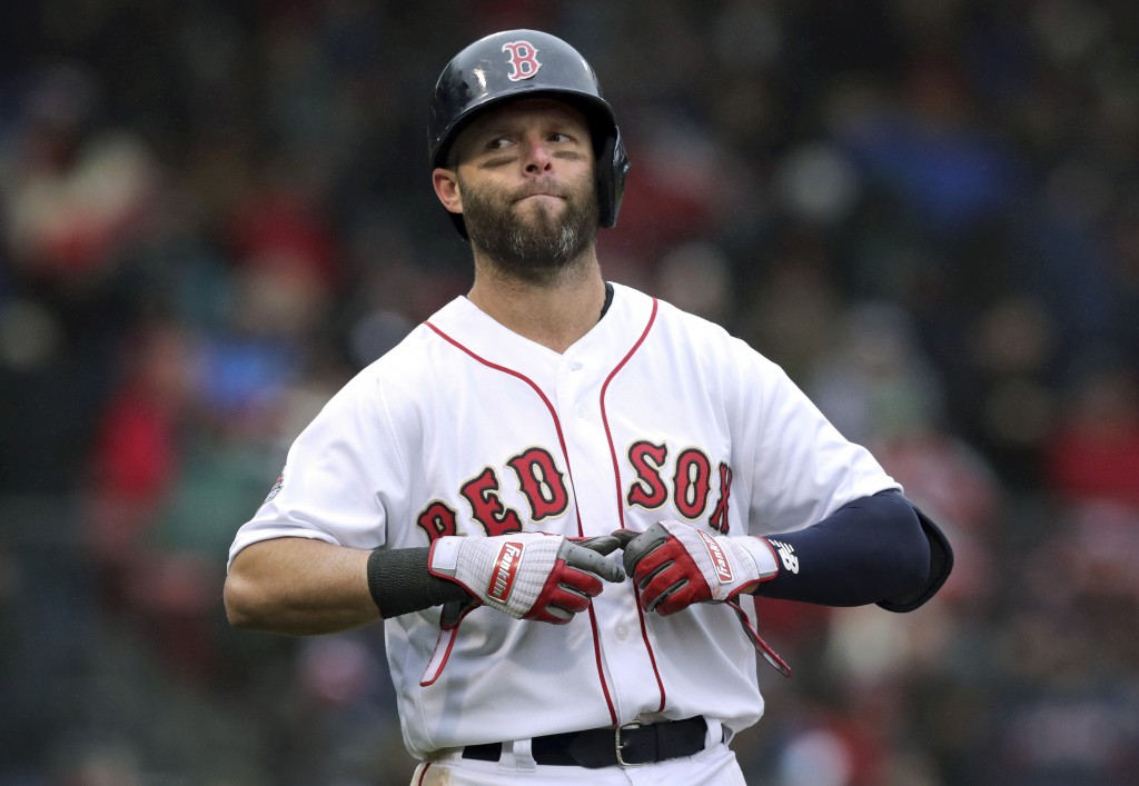 FILE - In this Tuesday, April 9, 2019 file photo, Boston Red Sox's Dustin Pedroia takes off his gloves after lining out to right field to end the sixt...