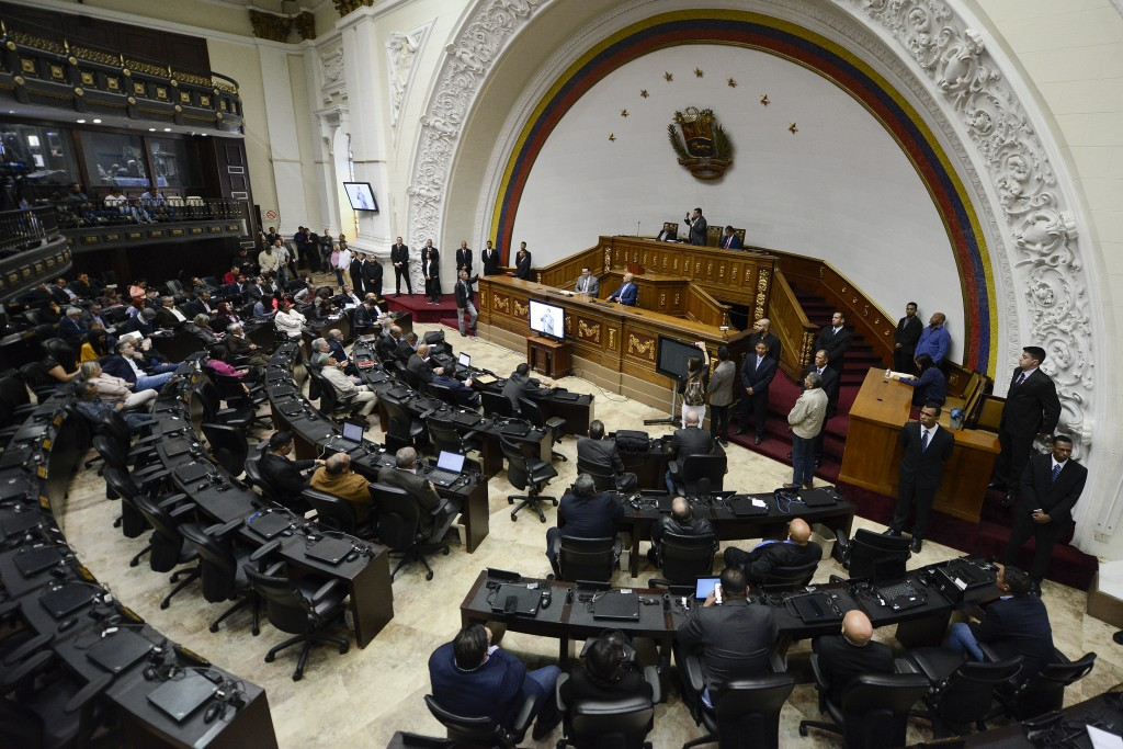 Lawmaker Luis Parra, who broke with opposition leader Juan Guaido and claims the presidency of the National Assembly, leads a session at the National ...