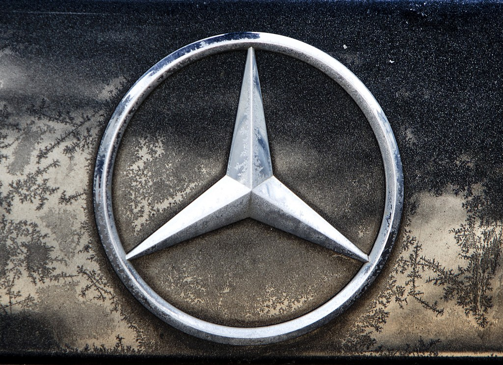 FILE - In this Wednesday, Feb. 6, 2019 file photo the logo of Daimler is photographed on a car in Frankfurt, Germany, Wednesday, Feb. 6, 2019. The mak...