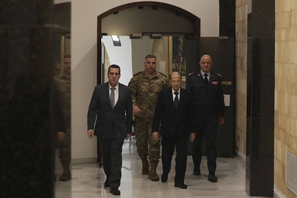 President Michel Aoun, second right, arrives to the cabinet meeting at the presidential palace in Baabda, east of Beirut, Lebanon, Wednesday, Jan. 22,...