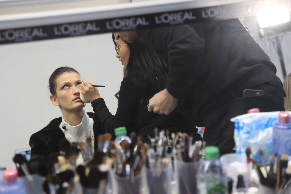 A model is made up backstage to the Elie Saab Haute Couture Spring/Summer 2020 fashion collection presented Tuesday Jan. 21, 2020 in Paris. (AP Photo/...