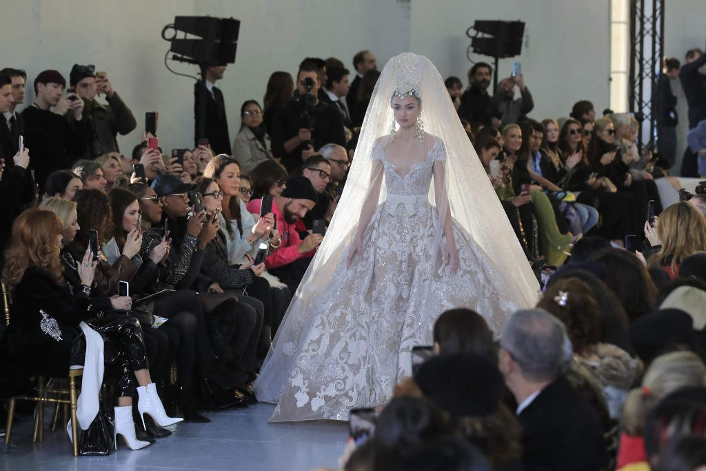 A model wears a creation for the Elie Saab Haute Couture Spring/Summer 2020 fashion collection presented Wednesday Jan. 22, 2020 in Paris. (AP Photo/M...