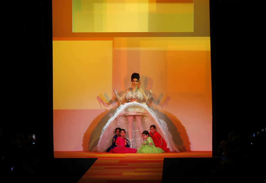 FILE - In this Wednesday, Jan. 23, 2013 file photo, children appear under the weeding gown worn by model for French fashion fashion designer Jean-Paul...