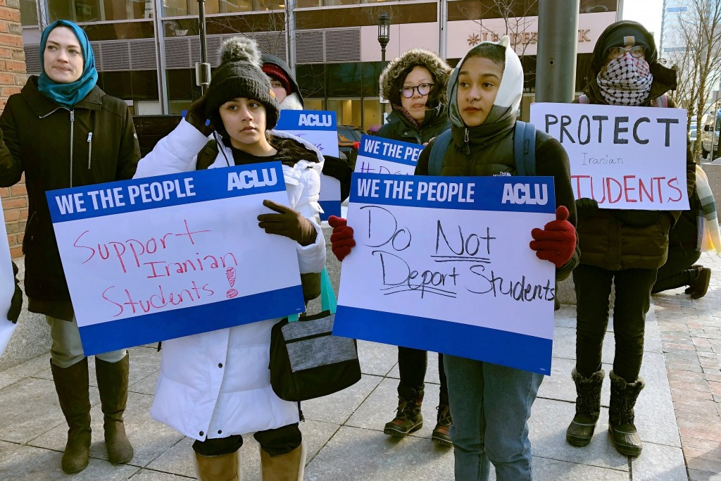Protesters stand outside the federal courthouse where a hearing was scheduled for Northeastern University student Shahab Dehghani, Tuesday, Jan. 21, 2...