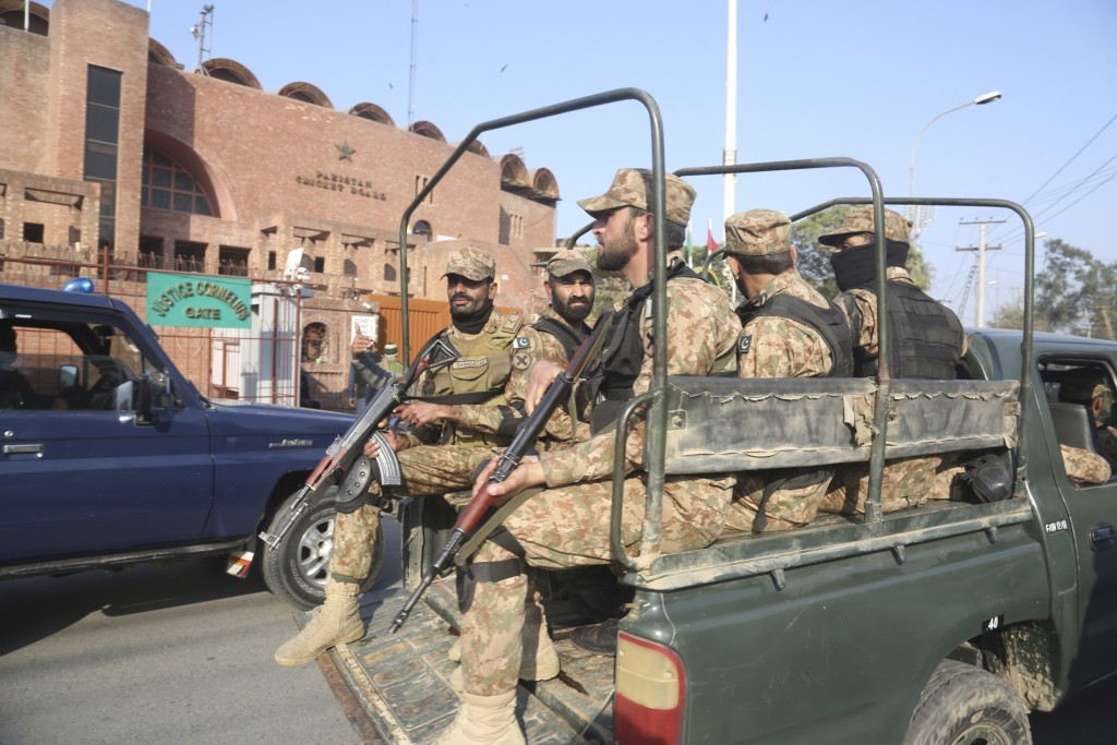 Armed army personnel guard outside the Gaddafi Stadium in Lahore, Wednesday, Jan. 22, 2020 ahead of Pakistan cricket team's practice session. The thre...