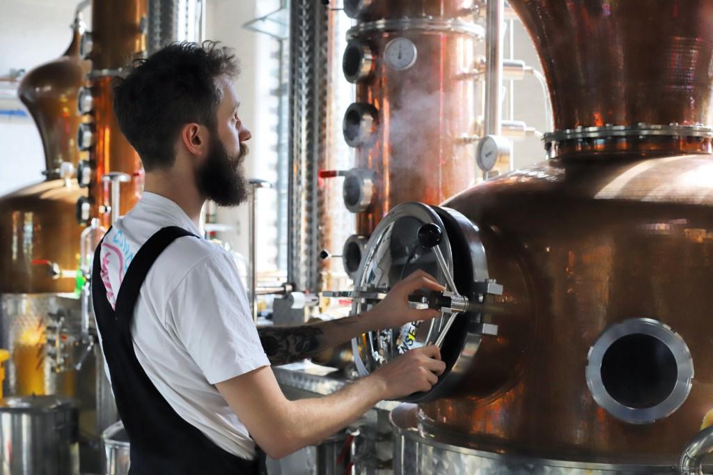 Distiller Sam Garbutt checks distillery controls in the Dewer's Distillery in Aberfeldy, the Scottish Highlands, in 2018, where they have produced Sco...