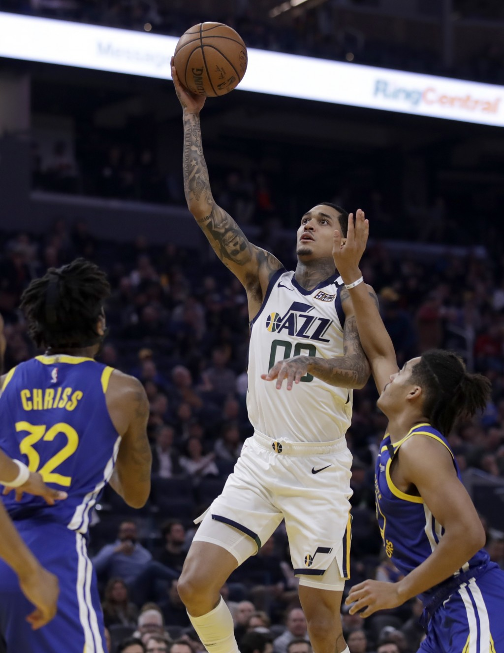 Utah Jazz guard Jordan Clarkson, center, shoots between Golden State Warriors' Marquese Chriss (32) and Jordan Poole in the first half of an NBA baske...