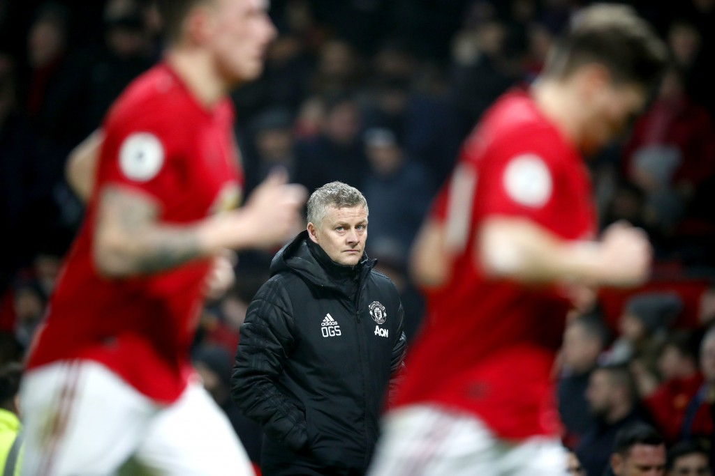 Manchester United manager Ole Gunnar Solskjaer, centre, watches the action from the touchline, during the English Premier League soccer match between ...