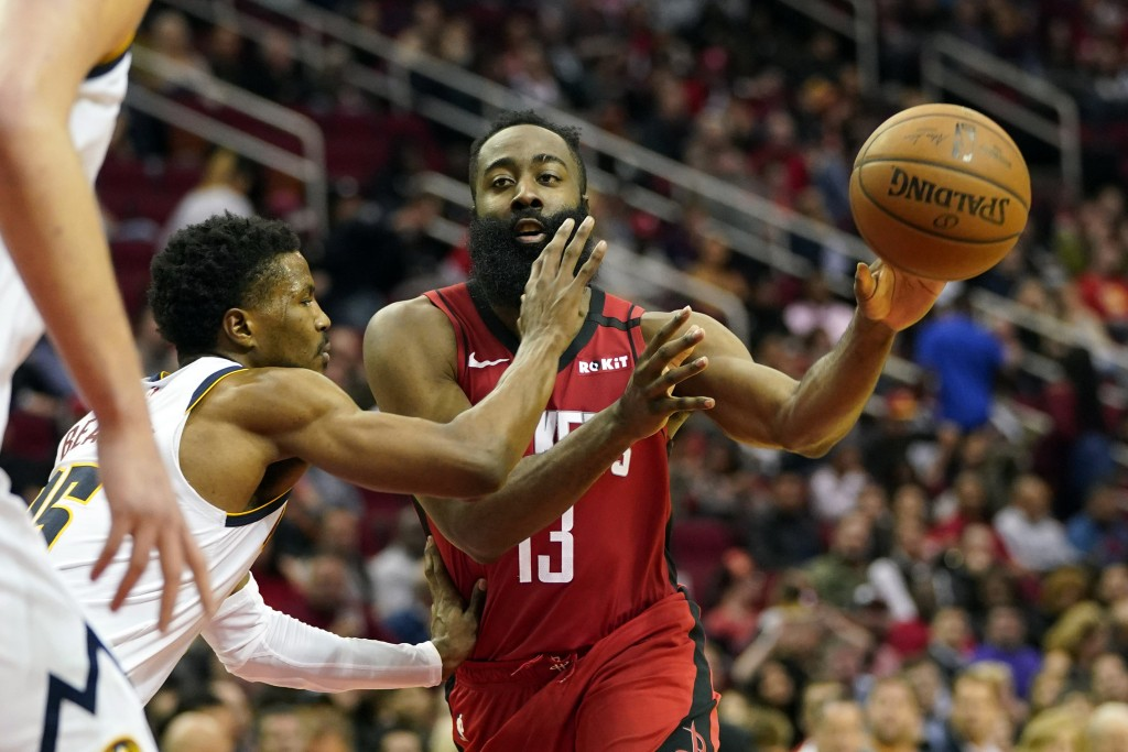 Houston Rockets' James Harden (13) passes the ball as Denver Nuggets' Malik Beasley (25) defends during the second half of an NBA basketball game Wedn...
