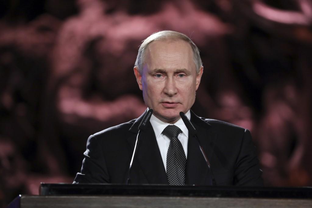 Russian President Vladimir Putin speaks during the Fifth World Holocaust Forum at the Yad Vashem Holocaust memorial museum in Jerusalem, Israel, Thurs...