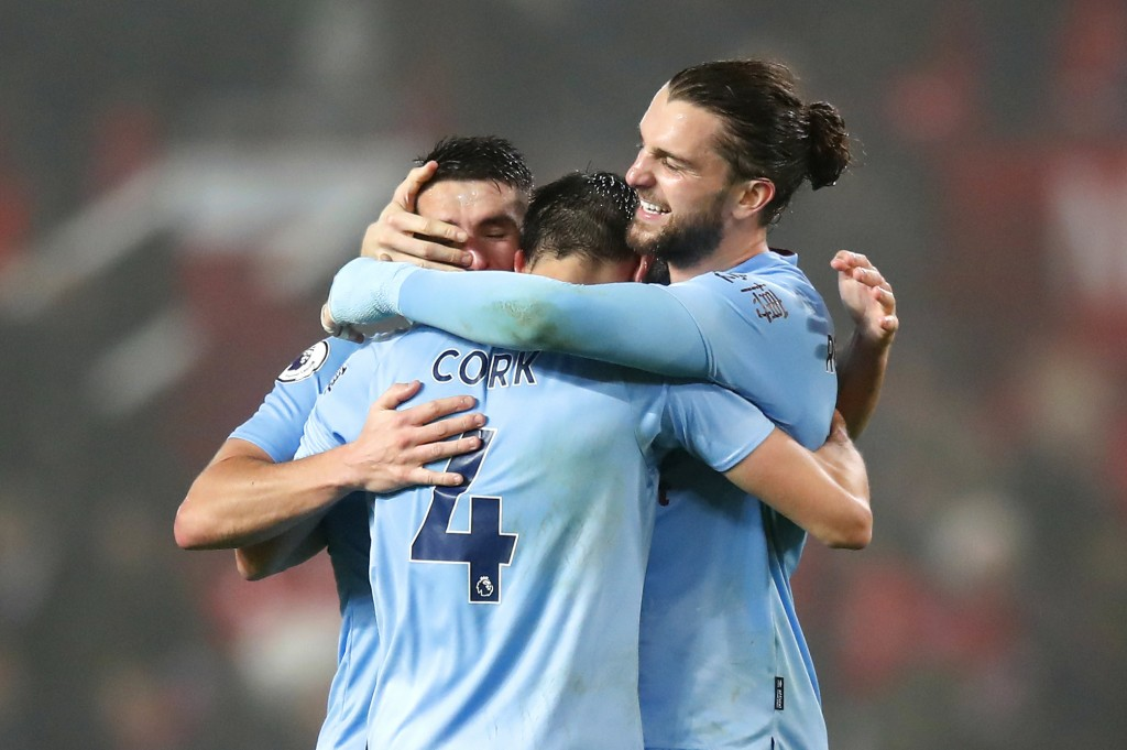 Burnley's Jay Rodriguez, right, celebrates with his teammates at the end of the Premier League match at Old Trafford, Manchester, Wednesday January 22...