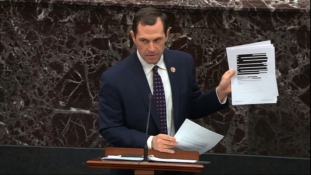 In this image from video, House impeachment manager Rep. Jason Crow, D-Colo., holds up documents released by the Office of Management and Budget (OMB)...