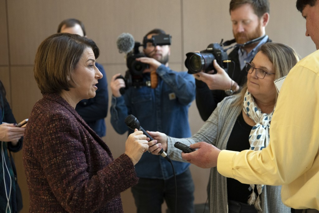 Democratic presidential candidate Sen. Amy Klobuchar, D-Minn., speaks to member of the media before heading back to the Capitol for the impeachment tr...