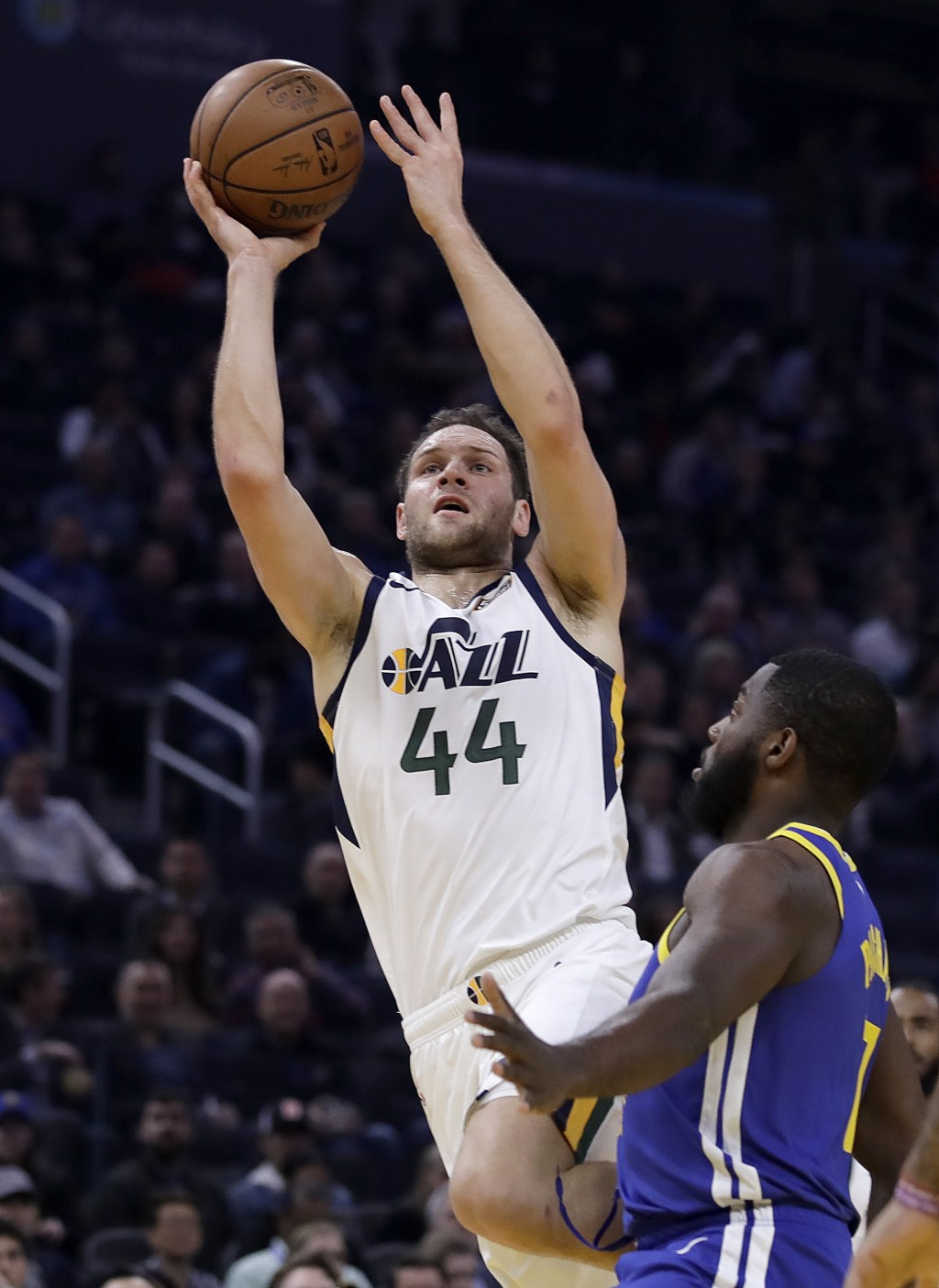 Utah Jazz forward Bojan Bogdanovic (44) shoots over Golden State Warriors' Eric Paschall in the first half of an NBA basketball game Wednesday, Jan. 2...