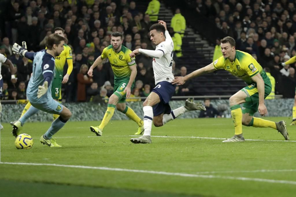 Tottenham's Dele Alli scores against Norwich City during the English Premier League soccer match between Tottenham Hotspur and Norwich City at the Tot...