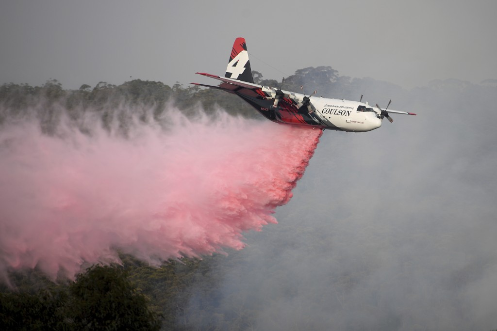 In this Jan. 10, 2020, photo, Rural Fire Service large air tanker 134, operated by Coulson Aviation in the U.S. state of Oregon, drops fire retardant ...