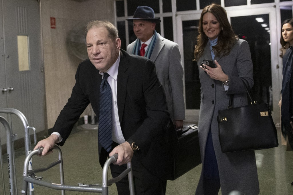 Harvey Weinstein, left, leaves the courtroom with his attorneys Arthur Aidala, and Donna Rotunno at the end of the first day of his trial on rape and ...