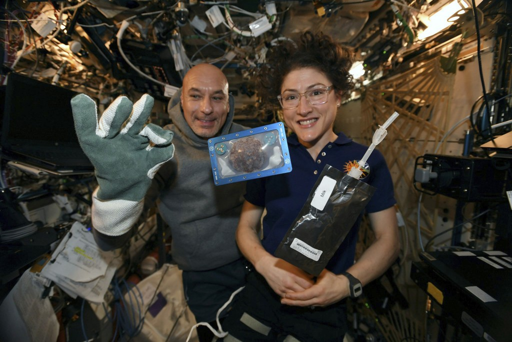 In this photo made available by U.S. astronaut Christina Koch via Twitter on Dec. 26, 2019, she and Italian astronaut Luca Parmitano pose for a photo ...