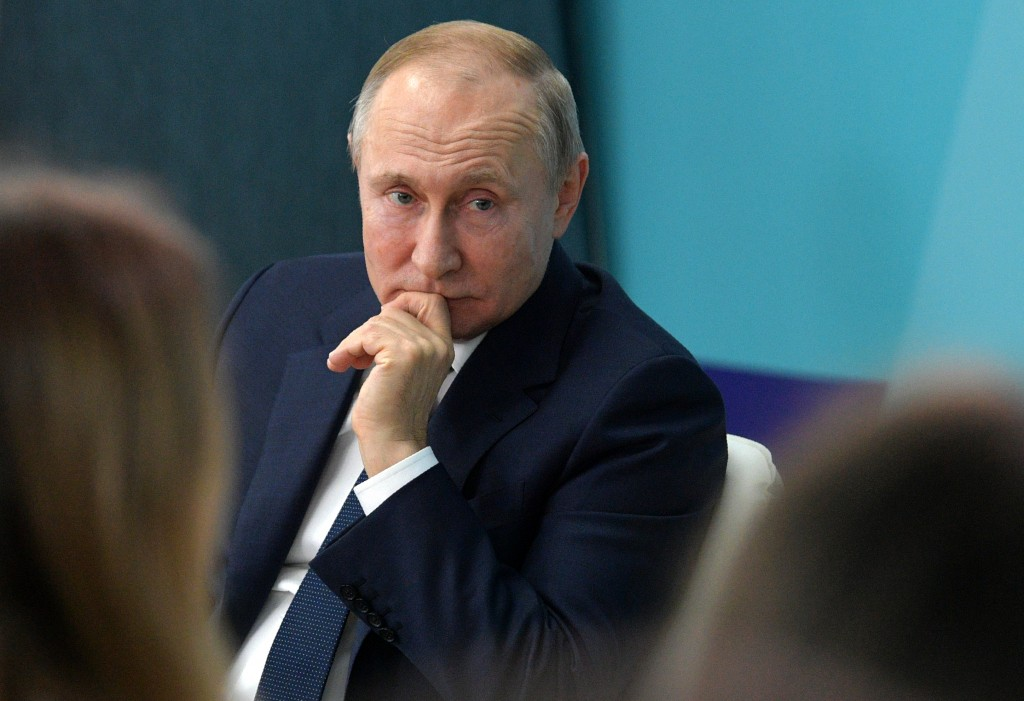 """Russian President Vladimir Putin listens for a question as he visits the """"Sirius"""" Educational Centre in the Black Sea resort of Sochi, Russia, Wednesd..."""
