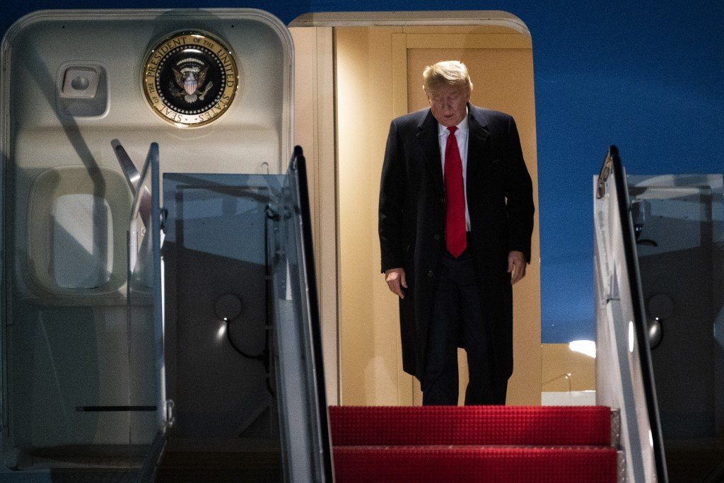 President Donald Trump exits Air Force One on Wednesday, Jan. 22, 2020, at Andrews Air Force Base, Md., after returning from the World Economic Forum ...