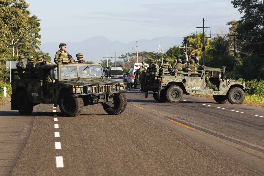 Mexican National Guards block a highway in Ciudad Hidalgo, Mexico after a group of Central American migrants crossed the border from Guatemala to Mexi...