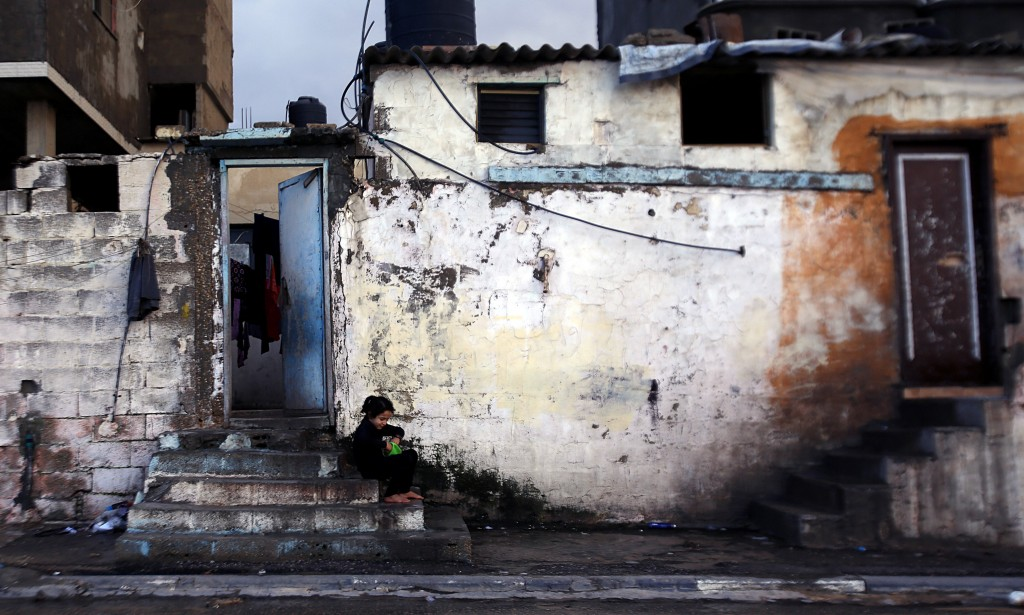 A Palestinian girl sits front of her house at the Shati Refugee Camp in Gaza City during a windstorm, Wednesday, Jan. 22, 2020. (AP Photo/Hatem Moussa...