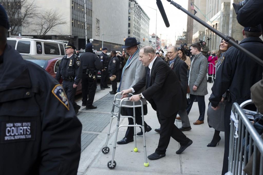 Harvey Weinstein leaves a Manhattan courthouse following a day in his trial on rape and sexual assault charges, Wednesday, Jan. 22, 2020 in New York. ...
