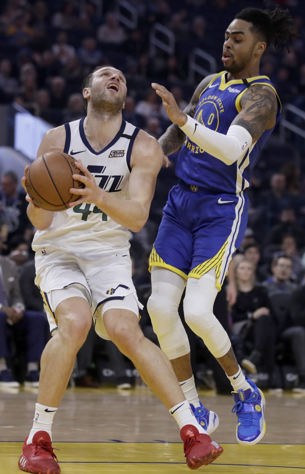 Utah Jazz forward Bojan Bogdanovic, left, looks to shoot against Golden State Warriors' D'Angelo Russell (0) in the first half of an NBA basketball ga...