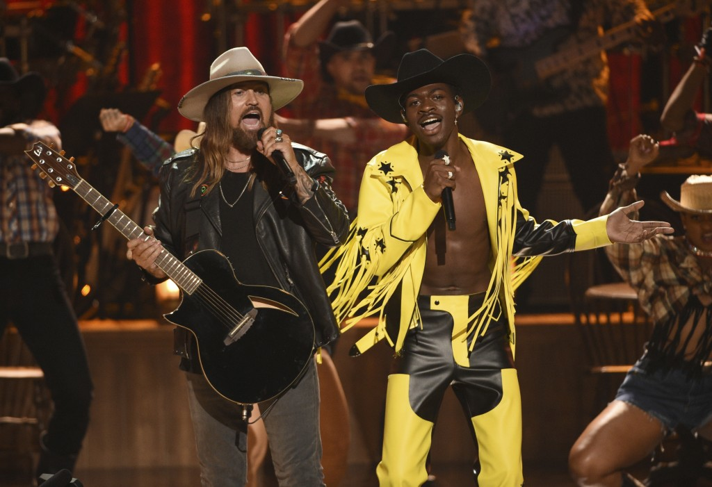 "FILE - This June 23, 2019 file photo shows Billy Ray Cyrus, left, and Lil Nas X performing ""Old Town Road"" at the BET Awards in Los Angeles. The 2020 ..."